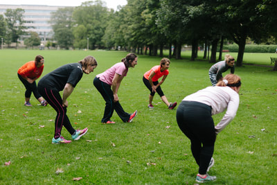 Fit Happy's Edinburgh boot camp for women. Ladies stretching in the Meadows.