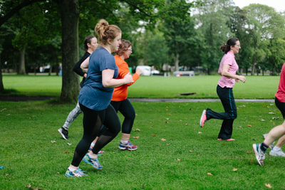 Women jogging at outdoor boot camp in the Meadows, Edinburgh. Fit & Happy Personal Training