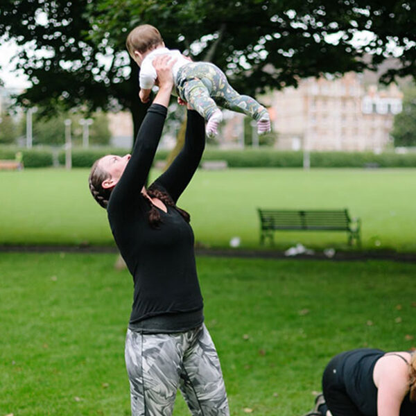 mum lifting her baby at fitandhappy Mamas exercise class